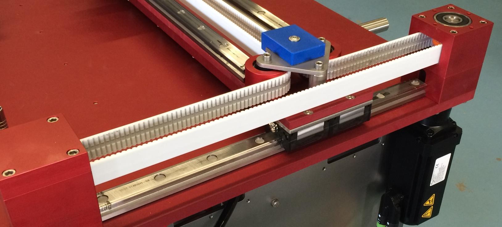 Single belt gantry system for positioning of a spray