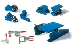 Tensioners and rubber suspension elements