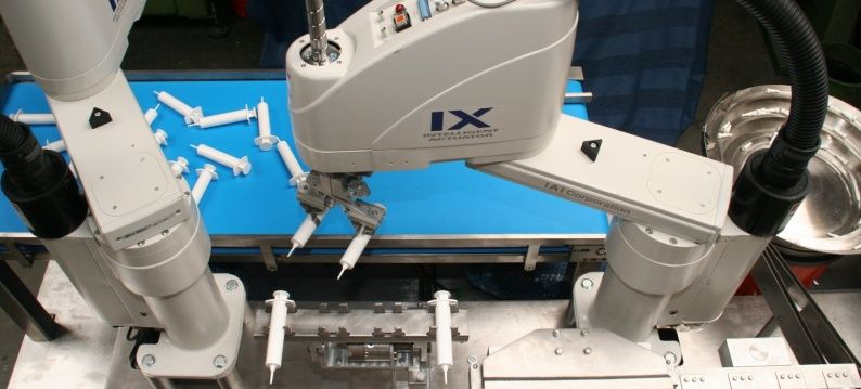 1 Slider IAI SCARA robots pick the syringes of the belt and position them to fill with medication