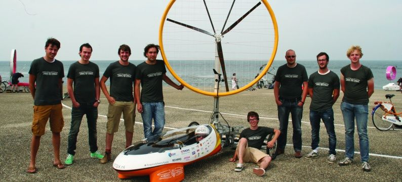 Team members of 'Stichting Rootbox' with wind powered vehicle Anemo 5